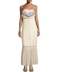 Vestido largo bordado en beige