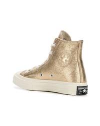 9a76e5a7c8c ... Zapatillas altas de cuero doradas de Converse ...