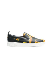Zapatillas slip-on en negro y dorado de Versace