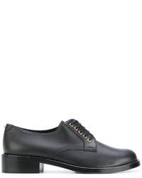 Zapatos con cordones de cuero negros de Salvatore Ferragamo
